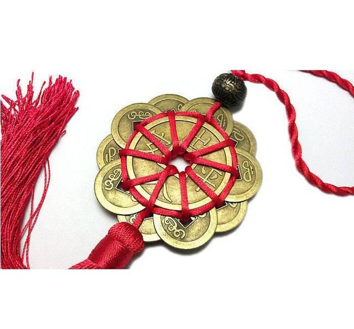 Монета в качестве амулета для привлечения денег и богатства